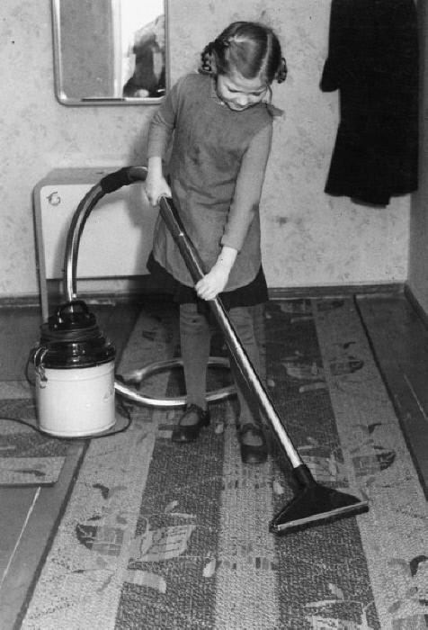 Girl Hoovering / Photo / c.1925