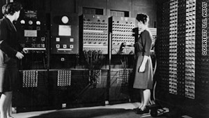 In 1946, Jean Jennings Bartik, left, and Francis Bilas Spence, right, worked as programmers on the first electronic general-purpose computer. In this photo, they are working with the ENIAC.  This photo is courtesy of CNN. For additional reading, see CNN.